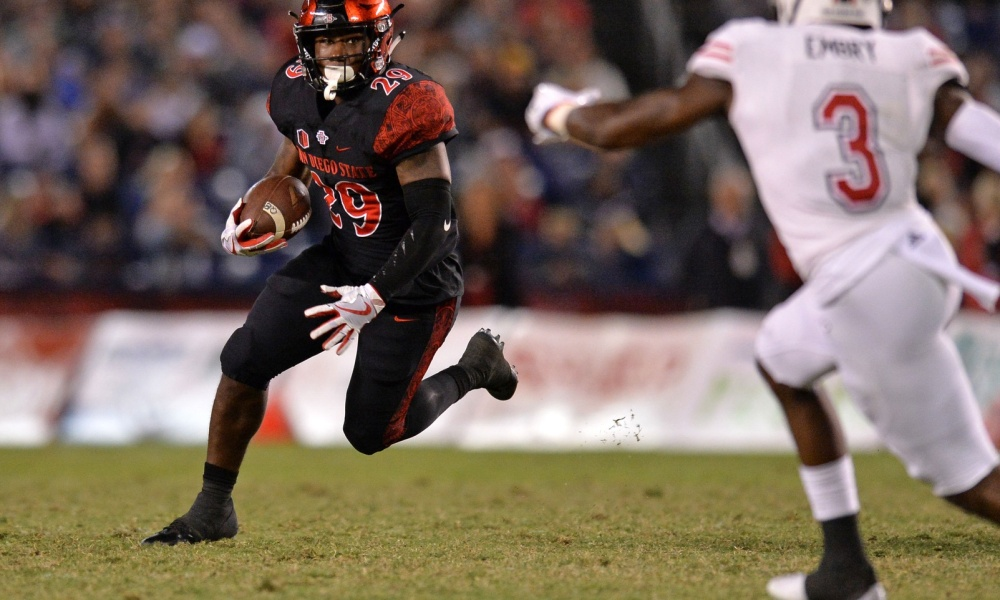 Sep 30, 2017; San Diego, CA, USA; San Diego State Aztecs running back Juwan Washington (29) is defended by Northern Illinois Huskies cornerback Jalen Embry (3) during the third quarter at SDCCU Stadium. Mandatory Credit: Jake Roth-USA TODAY Sports