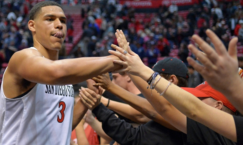 Mar 3, 2018; San Diego, CA, USA; San Diego State Aztecs guard Trey Kell (3) celebrates a 79-74 win over Nevada Wolf Pack with fans at Viejas Arena. Mandatory Credit: Jake Roth-USA TODAY Sports
