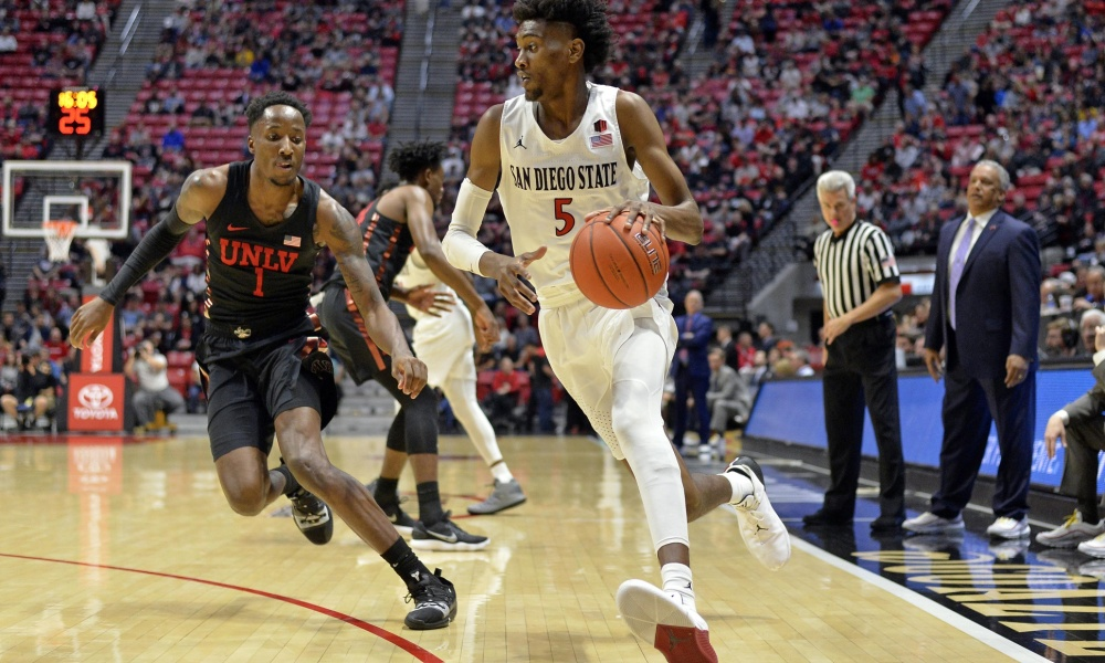Jan 26, 2019; San Diego, CA, USA; San Diego State Aztecs forward Jalen McDaniels (5) is defended by UNLV Rebels guard Kris Clyburn (1) during the first half at Viejas Arena. Mandatory Credit: Jake Roth-USA TODAY Sports