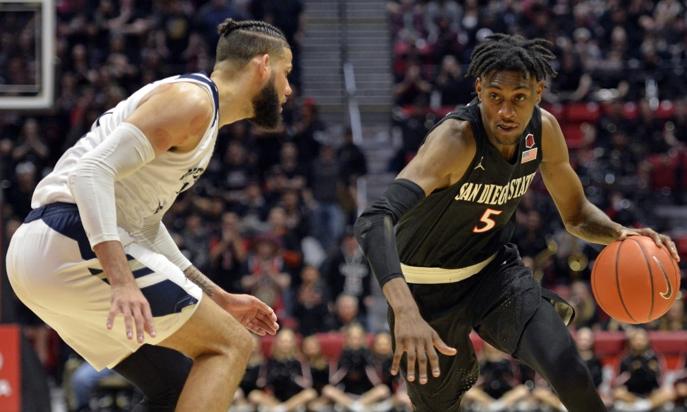 Feb 20, 2019; San Diego, CA, USA; San Diego State Aztecs forward Jalen McDaniels (5) is defended by Nevada Wolf Pack forward Cody Martin (11) during the second half at Viejas Arena. Mandatory Credit: Jake Roth-USA TODAY Sports