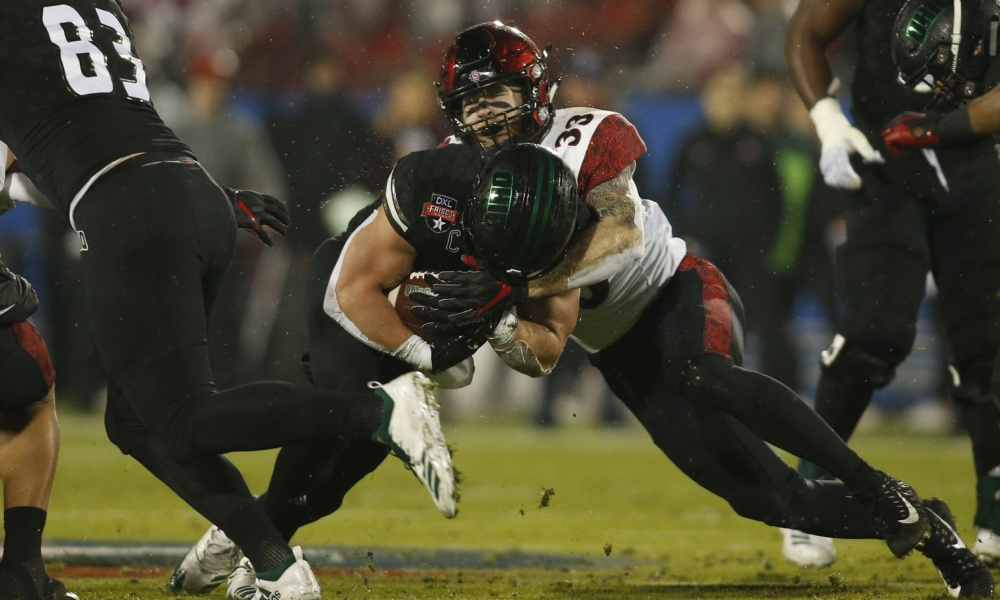 Dec 19, 2018; Frisco, TX, United States; Ohio Bobcats running back A.J. Ouellette (45) runs and is tackled by San Diego State Aztecs safety Parker Baldwin (33) in the first quarter in the 2018 Frisco Bowl at Toyota Stadium. Mandatory Credit: Tim Heitman-USA TODAY Sports